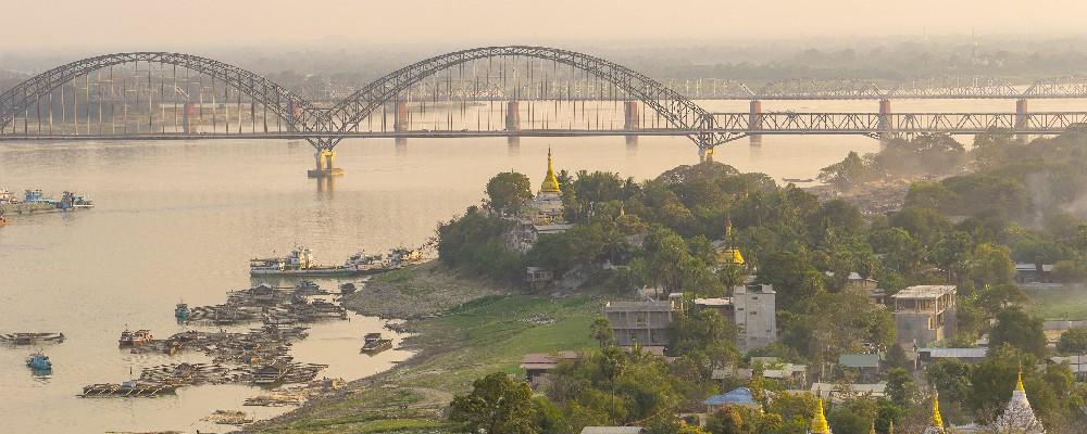 Bridge over Ayeyarwady River at sunset, Sagaing Region, Myanmar.