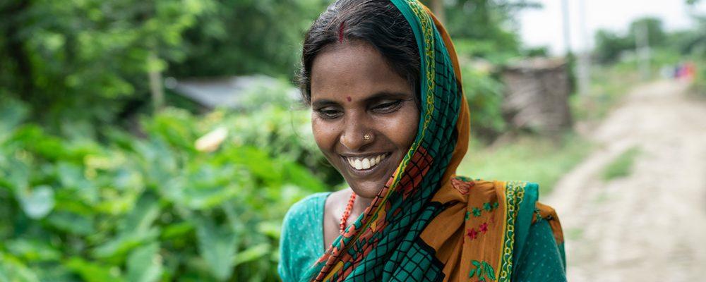 Sulochana Devi, local female farmer and leader, smiling in her village in India